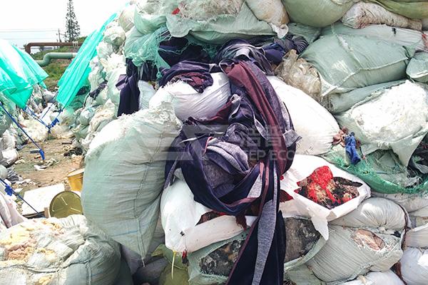 推积如山的废布织物如何处理?织物破碎机成完美解决方案